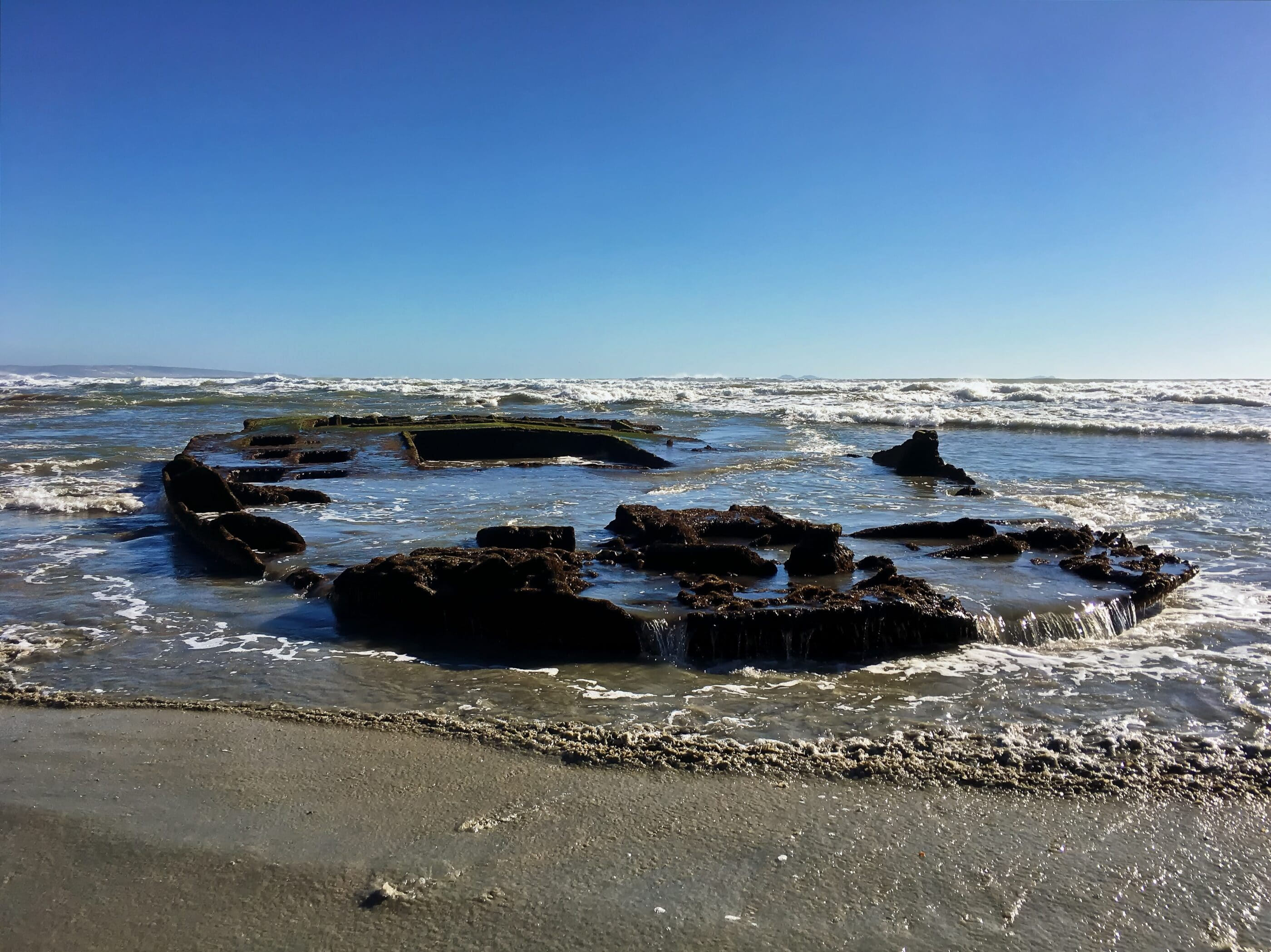 SS Monte Carlo shipwreck revealed on the Coronado beach during low tide.