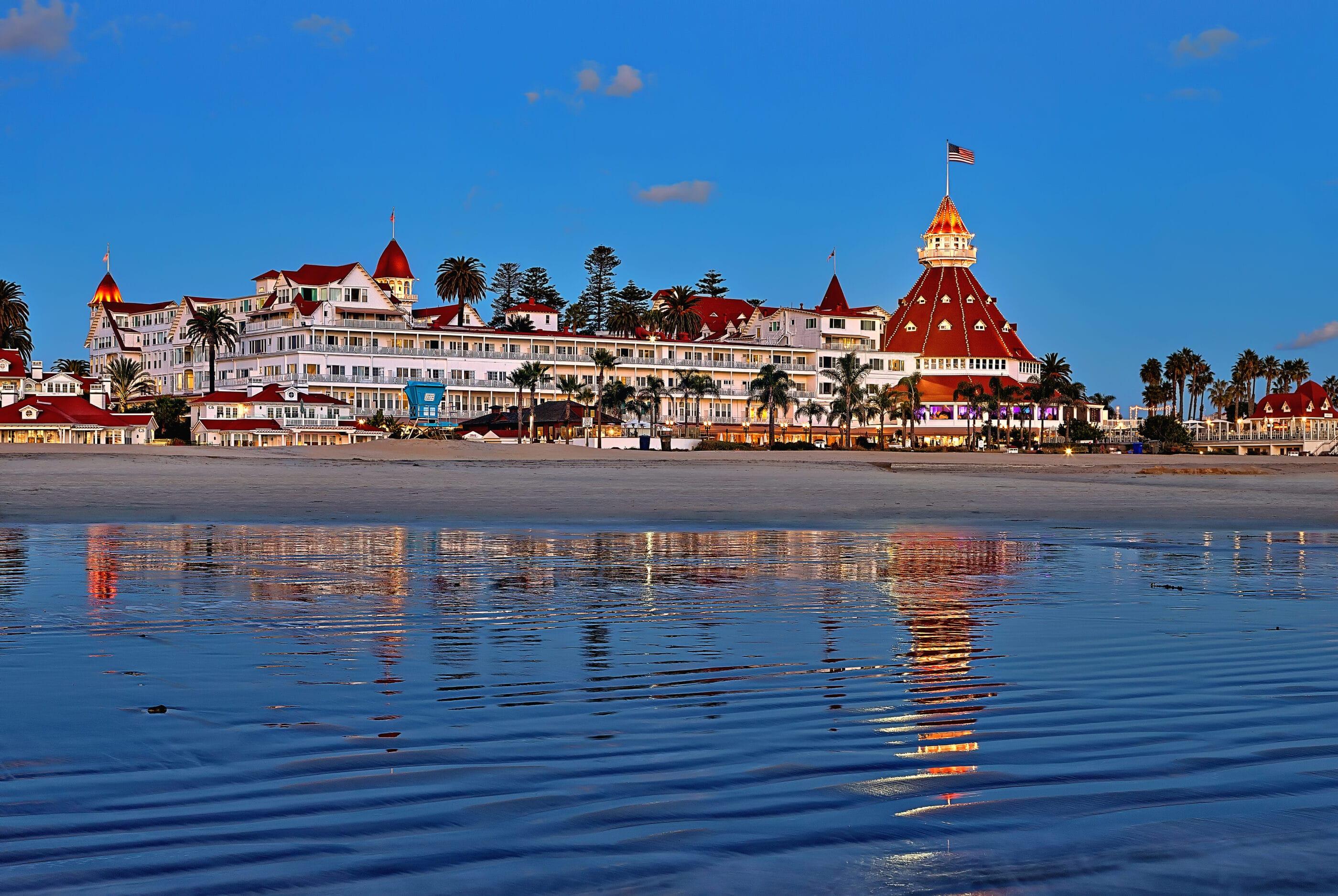 View of Hotel del Coronado in the evening over the beach.