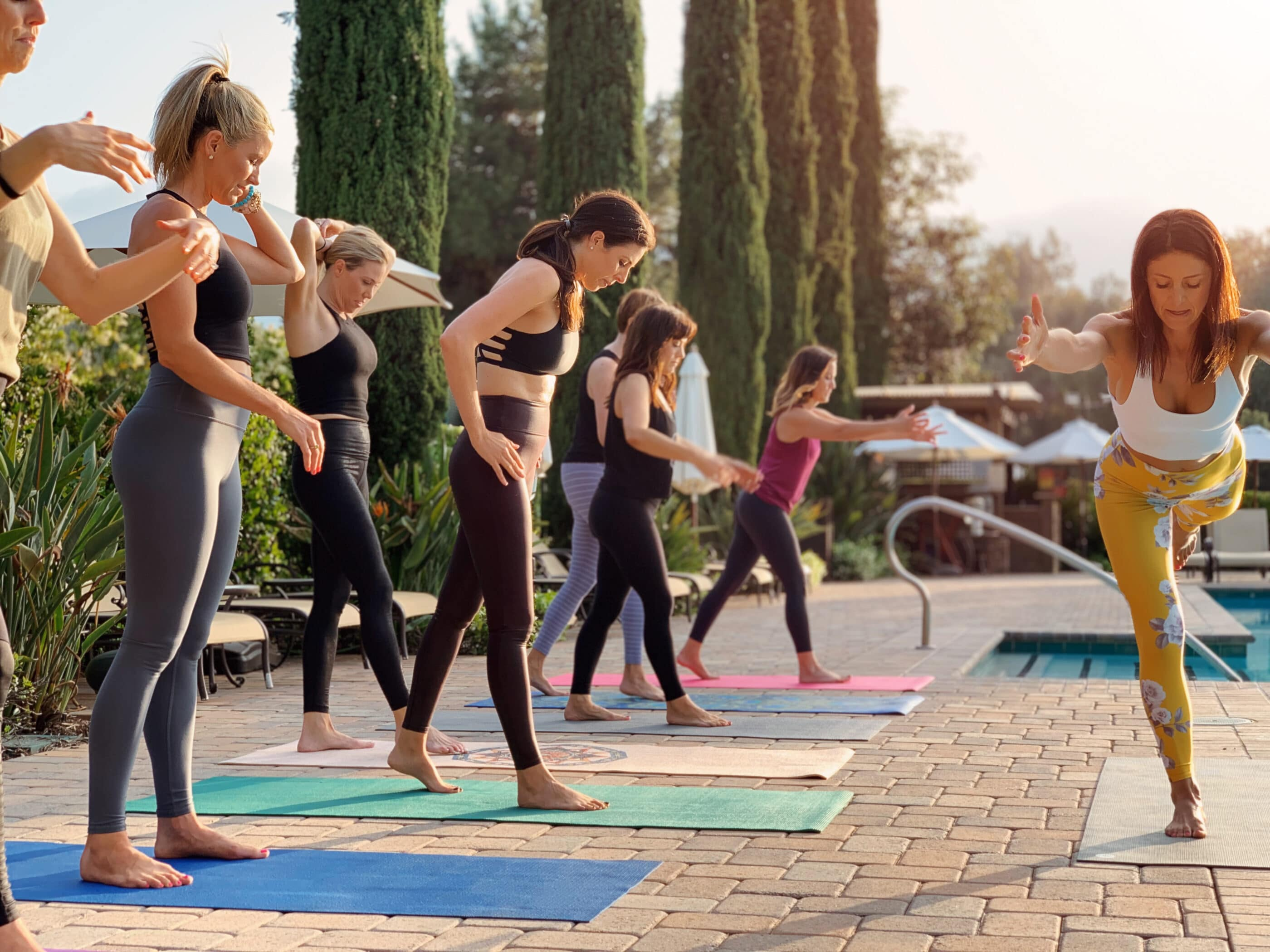 Guests do yoga by the spa pool