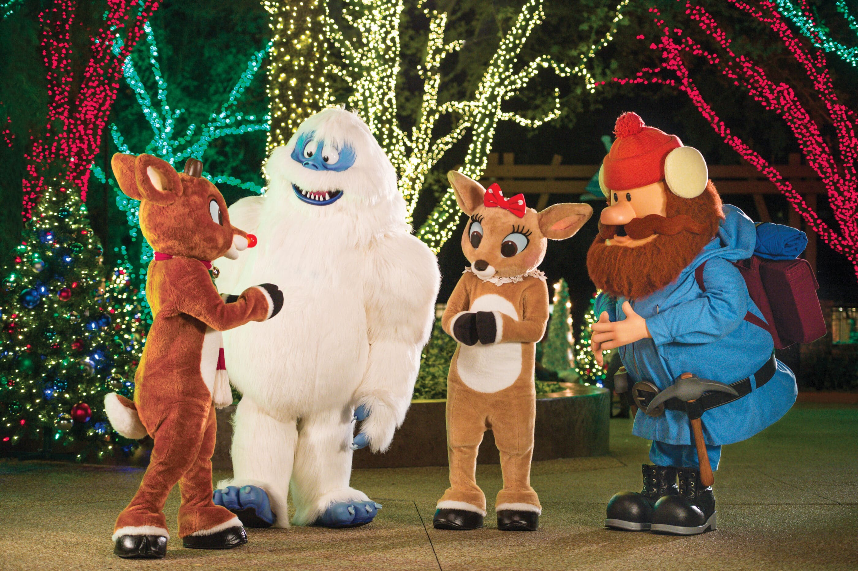 Rudolph and friends in front of holiday decor at SeaWorld San Diego's Christmas Celebration.