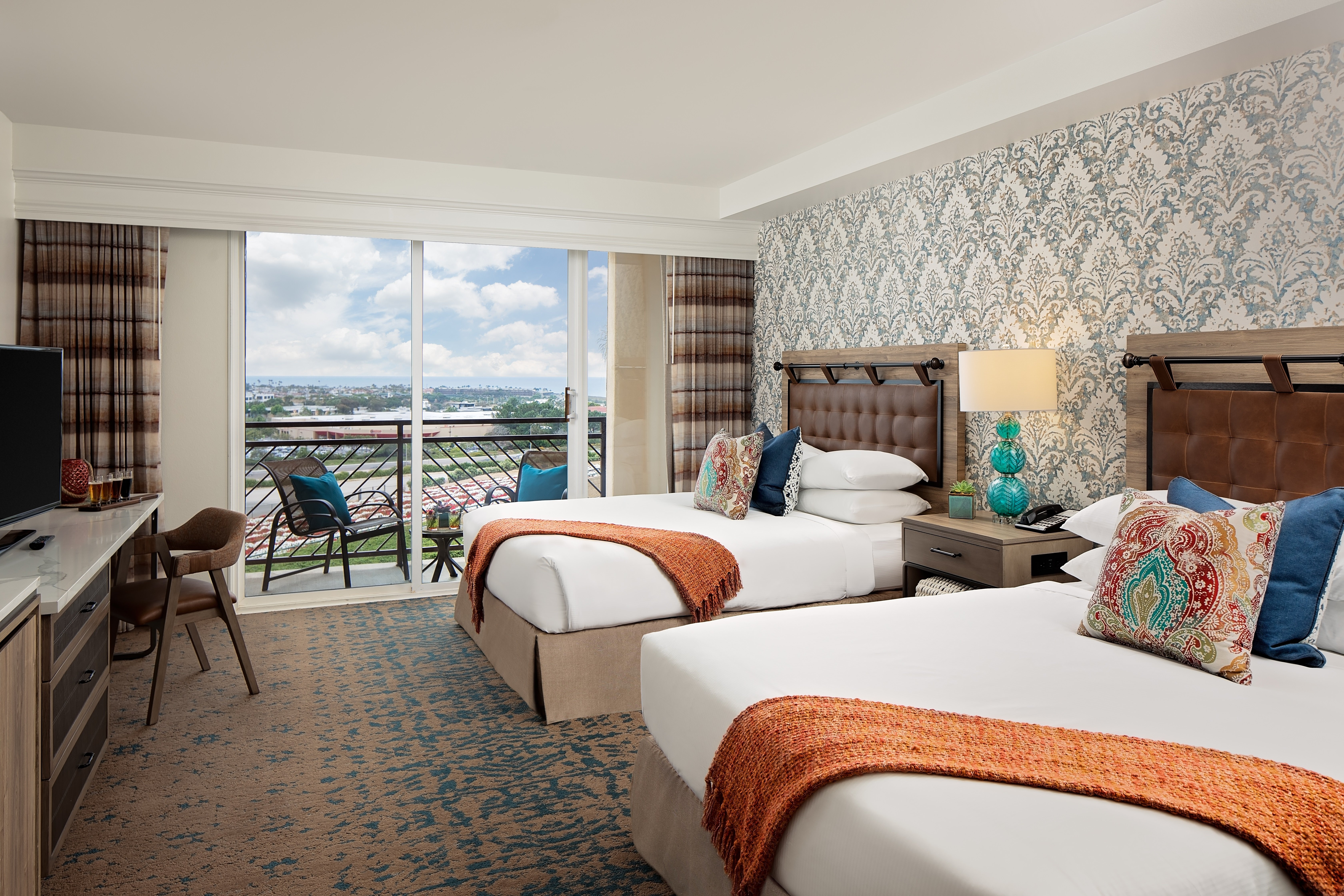 A two queen room interior at Cassara Carlsbad