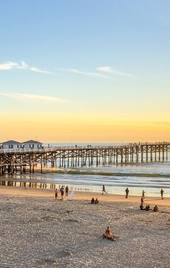 Crystal Pier in Pacific Beach at sunset.