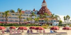 Beach chairs on the sand in front of Hotel del Coronado in San Diego.