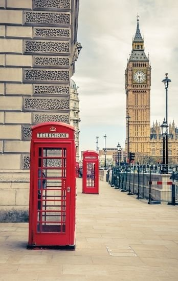 Red phone booths with Big Ben in the background.