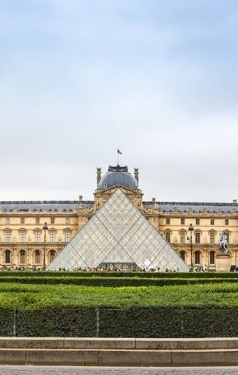 The glass entrance to the Louvre museum in Paris.