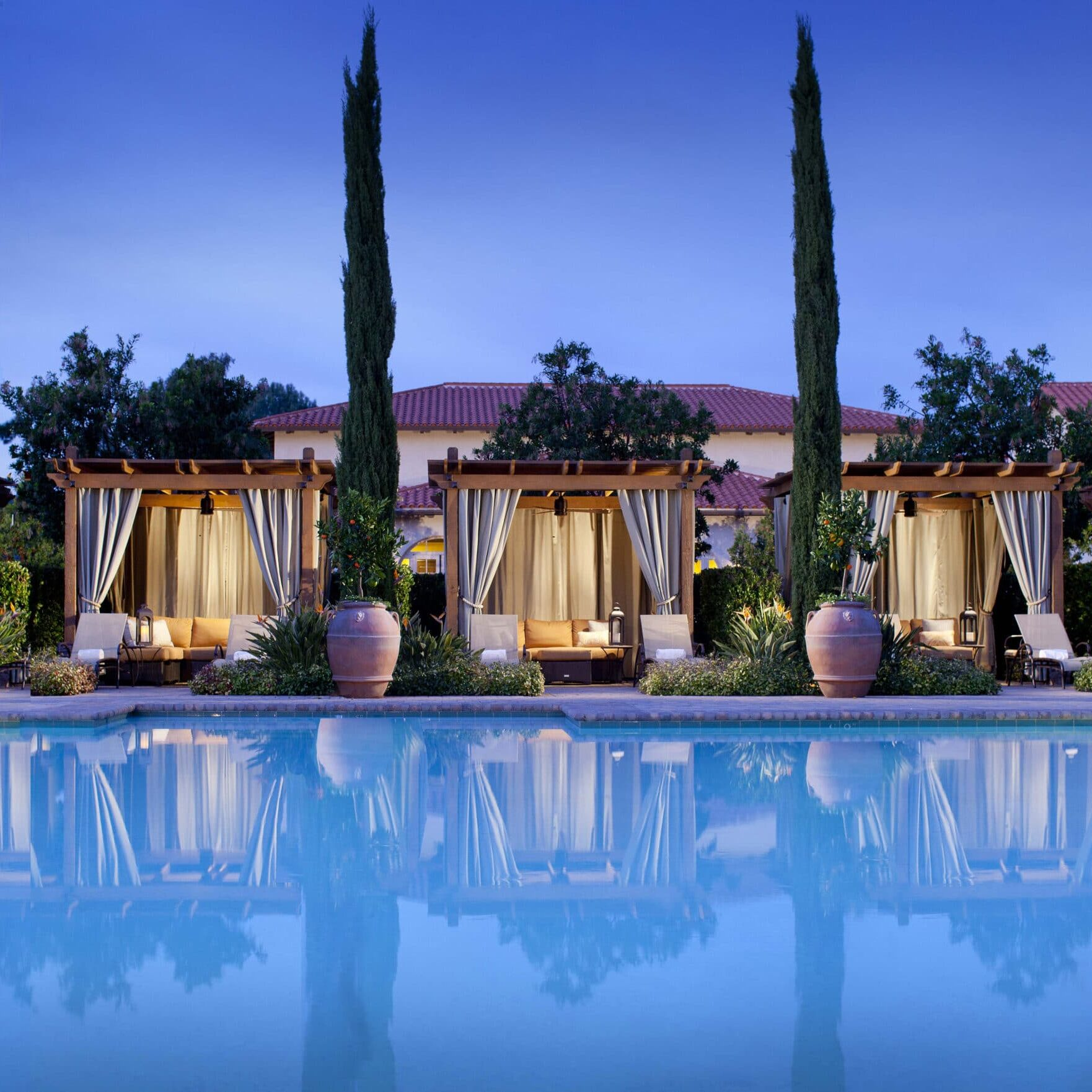 The spa pool and cabanas with evening light