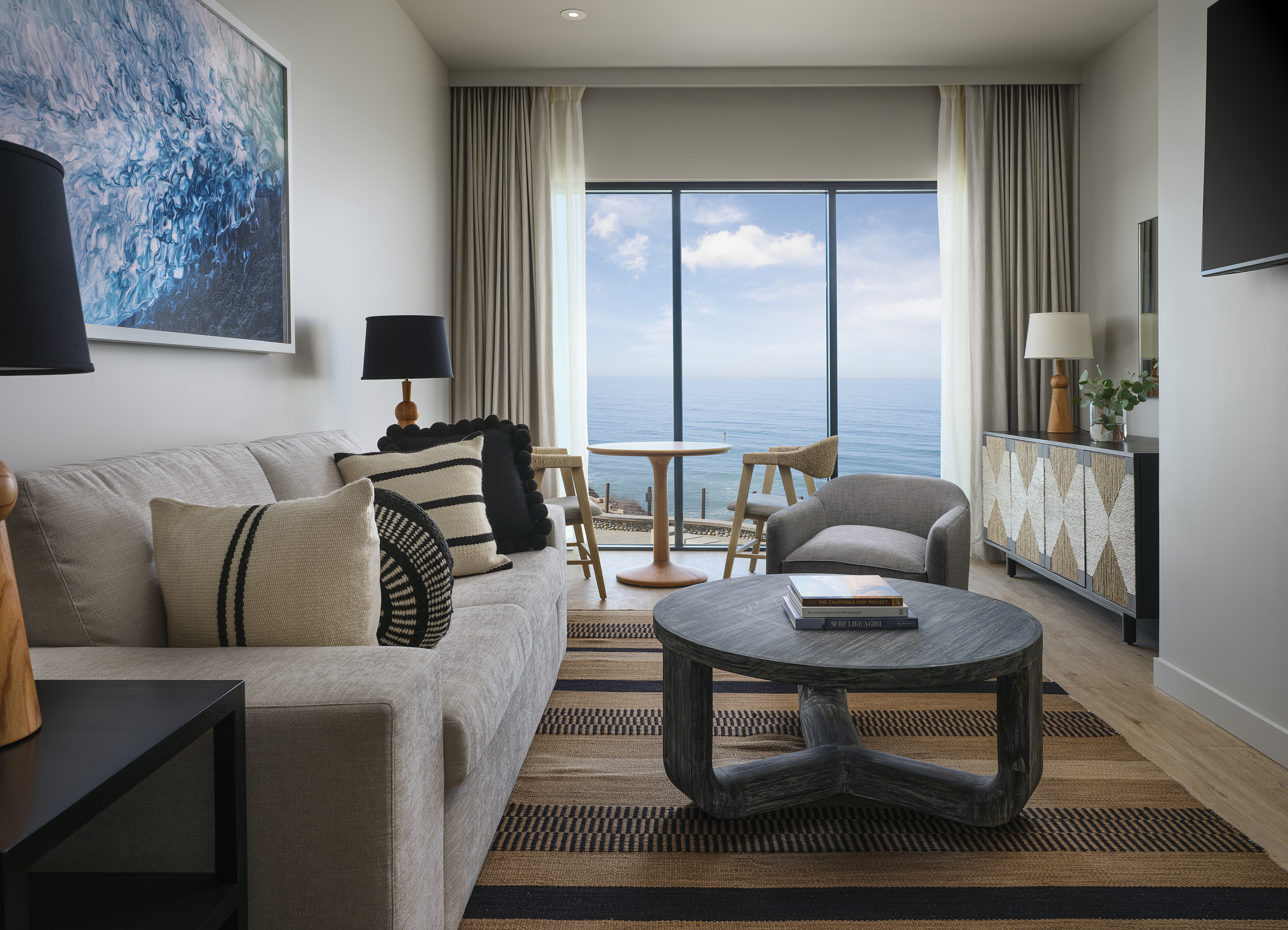 The living room with ocean view of a one bedroom suite.