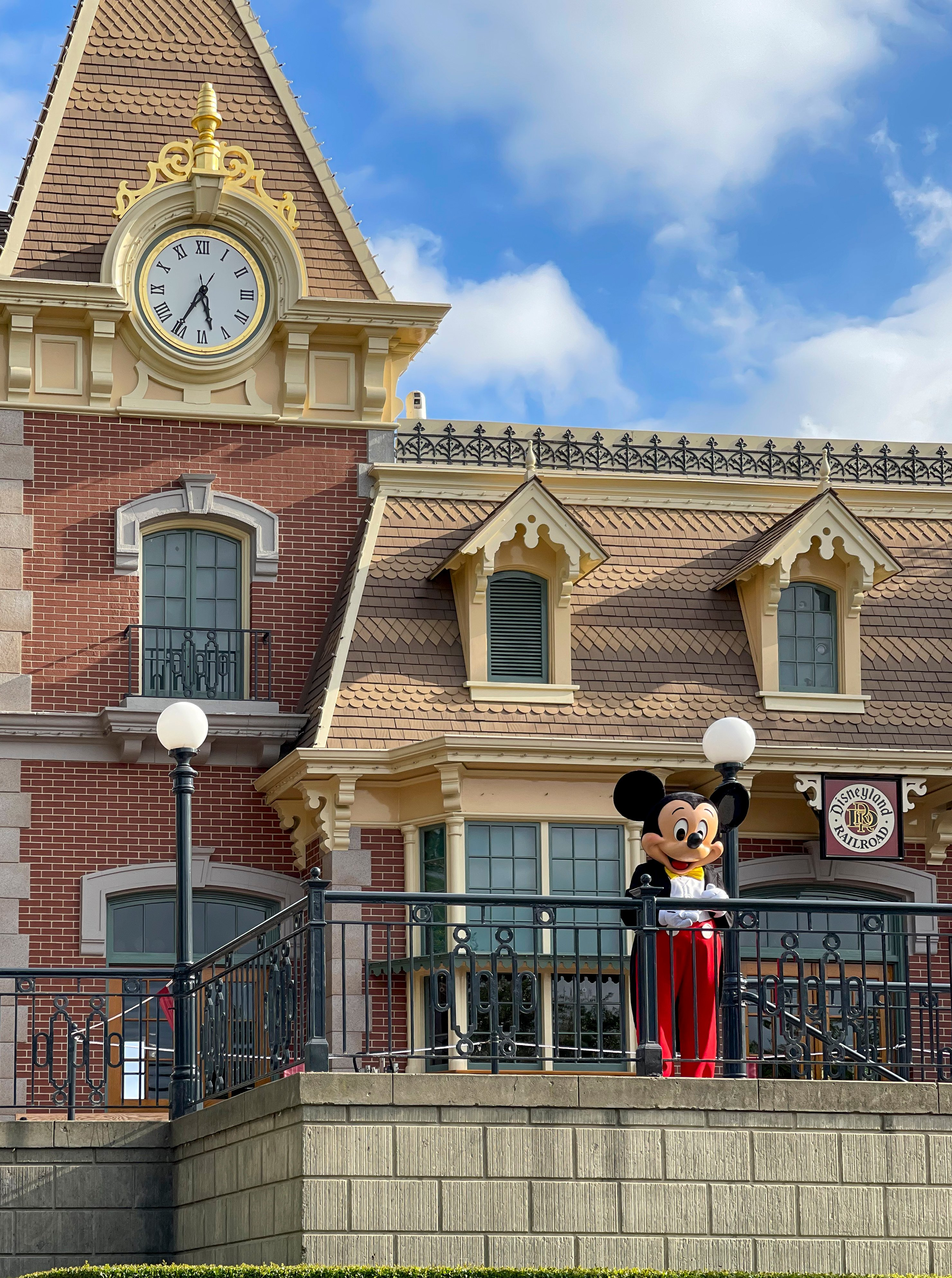 Mickey Mouse greets guests from the Disneyland Railroad station.