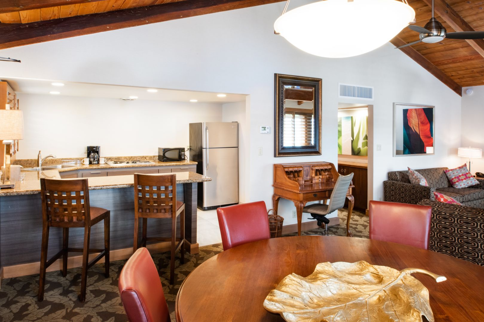 A kitchen and bar area in the Grand Marina Suite at Humphrey's Half Moon Inn.