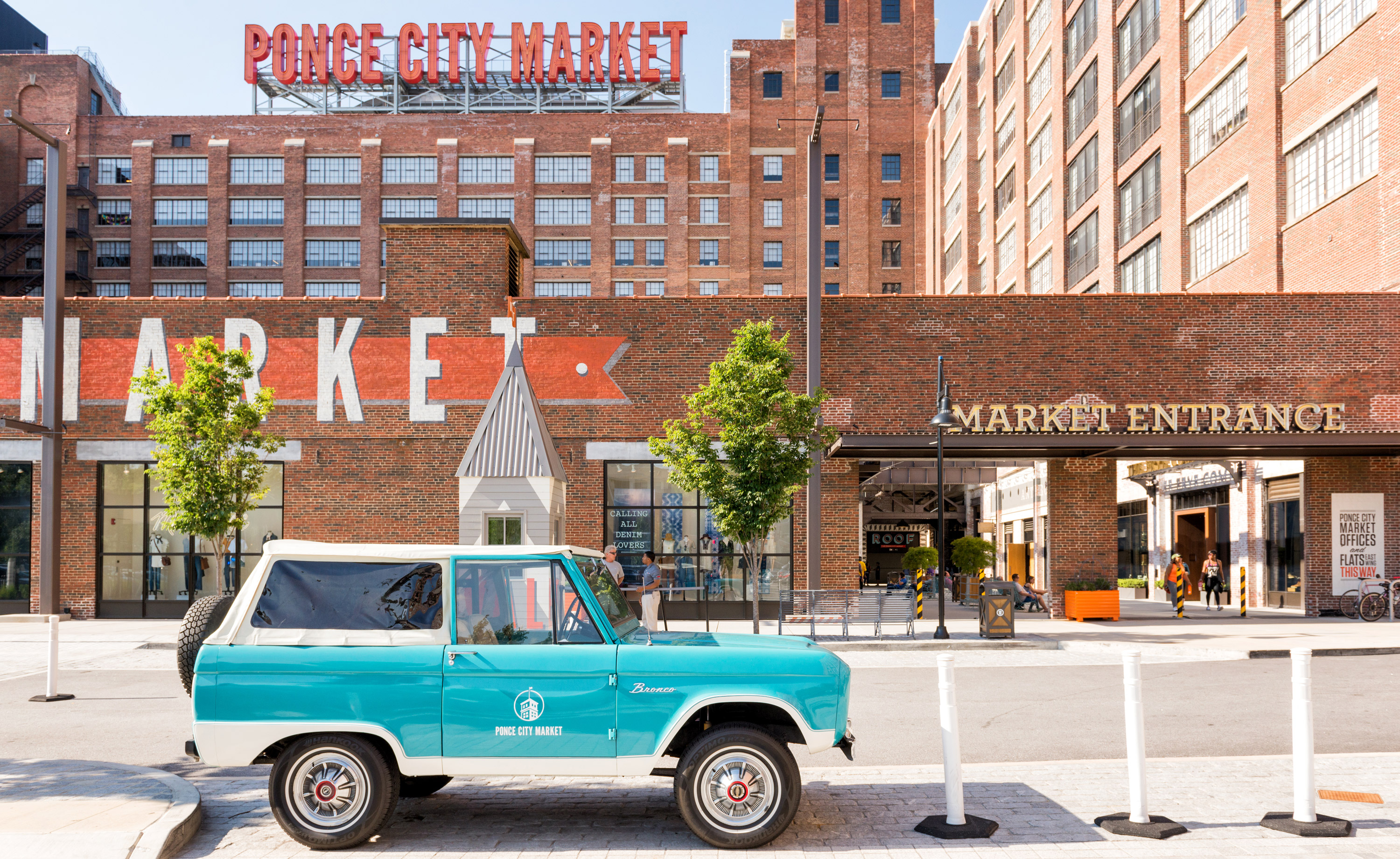 Leon, the 1967 Classic Ford Bronco parked in front of Ponce City Market.