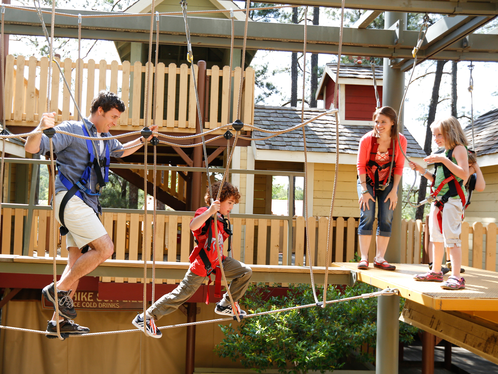 A family tackles an elevated ropes course at Stone Mountain Park in Atlanta.