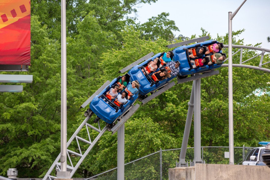 Guests ride a roller coaster at King's Dominion theme park in Virginia.